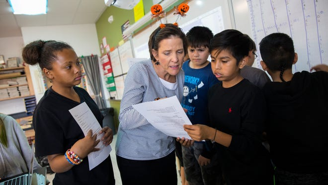 Teacher Cindy Colomb works with her students Tuesday at Hermosa Middle School in Farmington.