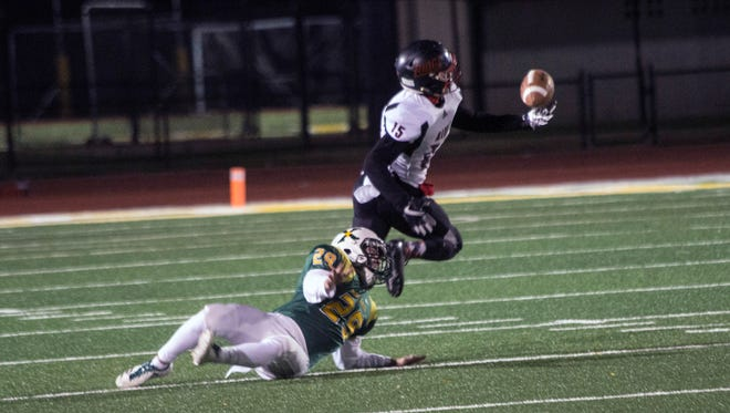 PRP's Shannon Bishop one hands a catch and scores on the opening play against St. X in a playoff game on Friday night. 11/10/17