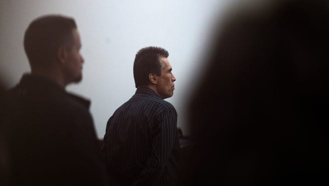 Defendant Rick Stallings stands as the jury enters the courtroom Thursday during his murder trial at Aztec District Court.