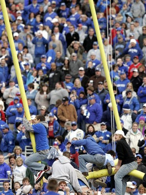 Kentucky fans tear down the goal post after Kentucky defeated Georgia 24-20 during a college football at Commonwealth Stadium in Lexington, Ky., on Saturday, Nov. 4, 2006. (AP Photo/James Crisp)