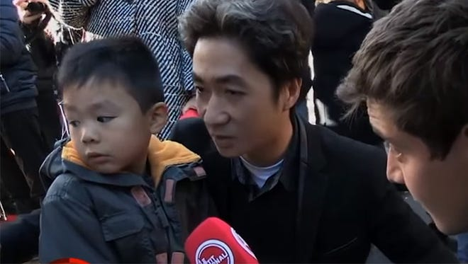 """Preschooler Brandon Le tells reporter Martin Weill the attacks on Friday night were conducted by """"bad guys"""" who were """"not very nice."""" He then expresses fear that his family will be forced to move, although his father, Angel Le, reassures him."""