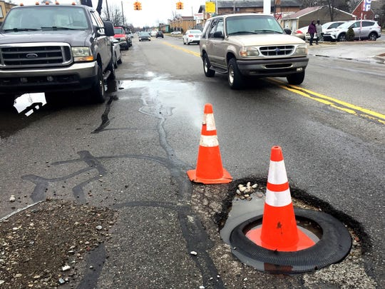 This pothole on Detroit's east side, on Morang near 7 Mile was nasty enough to be marked on Wednesday, Feb. 21, 2018 by two orange cones.