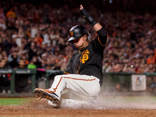 San Francisco Giants second baseman Joe Panik slides