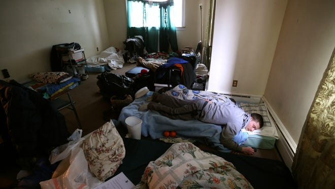 Travis Myrick shares his room at Reach Home on Prince St. with 6 others.  The house offers temporary housing for the homeless during the winter months. Guests can also work with social workers.