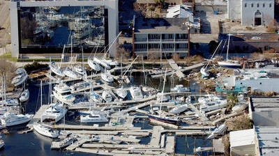 The boats docked at the pier on the end of South Palafox Street were shoved to the sea wall and left resting on top of each other after Hurricane Ivan in 2004. Escambia County Commissioner Lumon May is requesting that the State of Florida's Division of Emergency Management prioritize and complete a reconciliation of all projects related to Hurricane Ivan, which struck the county in September 2004 and caused approximately $226 million in damage.