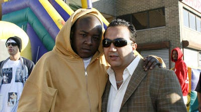 Sammy El Jamal, right, with rapper Jadakiss in 2006 at the grand opening of a car wash in Yonkers.