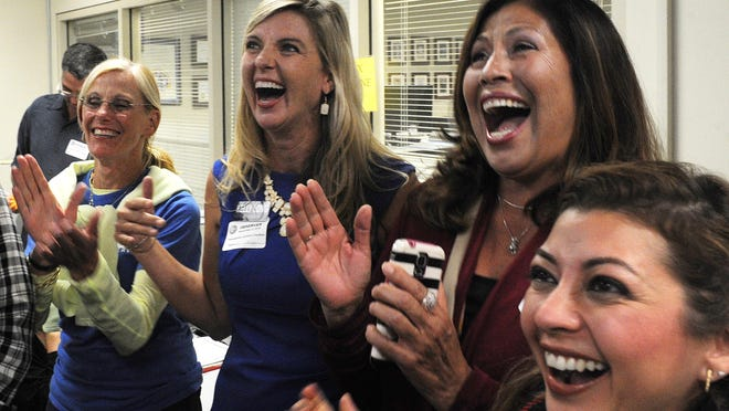 Gwen Speakes, from left, and her daughter Kelly Long, running for the 3rd District seat on the Ventura County Board of Supervisors, react to election numbers with Lora D. Hernandez and Veronica Miller on Tuesday night.