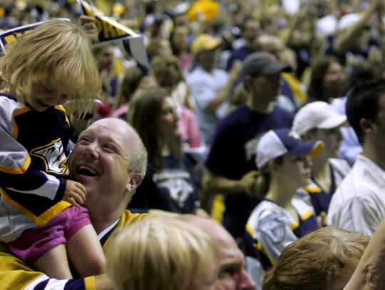Corey Nix and daughter Sami show their support for the Predators on July 19, 2007, during a pep rally for the team at the Sommet Center, as Bridgestone Arena was named at the time.
