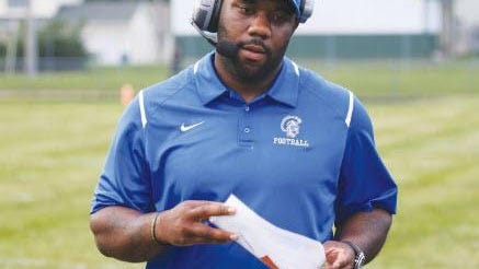 Taz Wallace, who resigned as Adrian Madison's football coach when the Michigan High School Athletic Association moved football to the spring, has agreed to return.
