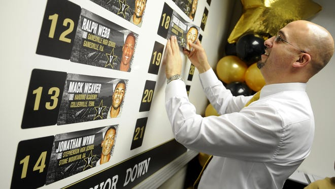 Former Vanderbilt coach James Franklin puts a newly signed recruit's name on the board during 2013 National Signing Day. That 2013 class already appears to be his best in three years with the Commodores.