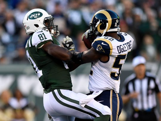Rams linebacker Alec Ogletree rips the ball out of the hands of Jets receiver Quincy Enunwa for the game-sealing interception in Los Angeles' 9-6 win on Sunday.
