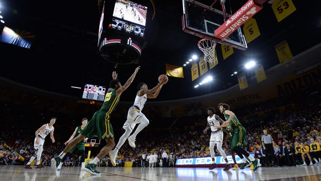 Arizona State's Tra Holder drives for a layup against San Francisco at Wells-Fargo Arena on Dec. 2, 2017.