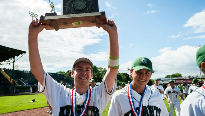 Rice celebrates winning the Division I high school boys baseball  championship between the South Burlington Rebels and the Rice Green Knights at Centennial Field on Saturday June 14, 2014 in Burlington, Vermont.