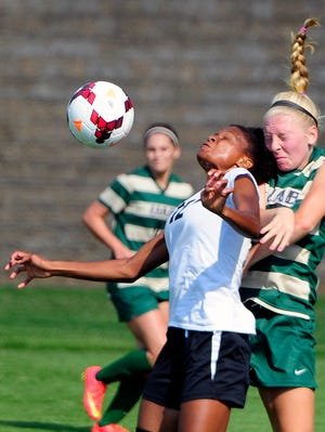 Vanderbilt sophomore forward Simone Charley (12) heads the ball in front of UAB's Meredith Schertzinger (5) during an exhibition game Thursday. As a freshman, Charley was an All-American in track and an All-SEC performer in soccer.