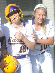 Early's Parker Smith, right, and Sydnee Shea (18) celebrate after Smith scored on Shea's home run off Peaster pitcher Rylie Melton in the first inning of a Region I-3A quarterfinal playoff game. Shea's homer tied the game at 2. Peaster went on to win the game 8-2 May 12, 2017, to sweep the Region I-3A quarterfinal playoff series at ACU's Poly Wells Field.