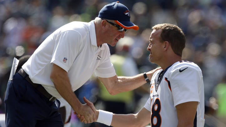 SEATTLE, WA - SEPTEMBER 21: Head coach John Fox of the Denver Broncos greets quarterback Peyton Manning #18 of the Denver Broncos as he warms up before the game against the Seattle Seahawks at CenturyLink Field on September 21, 2014 in Seattle,Washington.