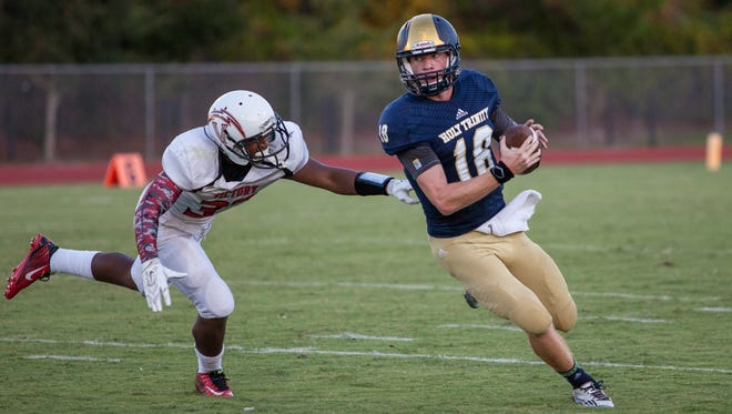 Holy Trinity?s Quarterback Daniel Welch (18) evades pressure from Victory Christian?s defender. (  Prep Sports )