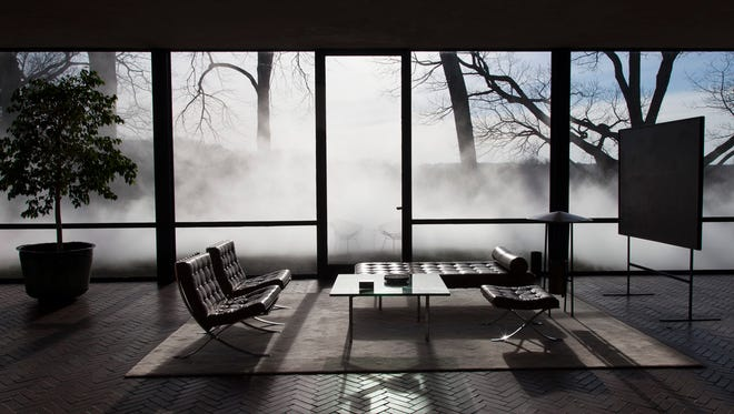 Artist Fujiko Nakaya's first fog installation on the east coast in 30 years can be viewed from inside or outside the Modernist Glass House it surrounds in New Canaan, Conn.