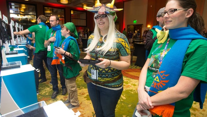 Megan Mann slashes through hundreds of enemies while playing Hyrule Warriors during PAX Prime 2014.