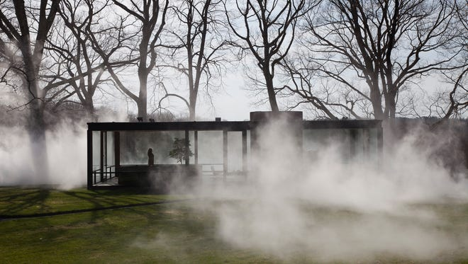 """This Saturday, April 19, 2014 photo provided by courtesy of The Glass House shows Tokyo-based artist, Fujiko Nakaya's latest """"fog installation,"""" meant to conceal the visible while accentuating usually invisible forces like wind. Like the glass structure itself, """"Fujiko Nakaya: Veil"""" plays on the visible and invisible, transparent and opaque, permanent and ephemeral.  The installation, about an hourÂ?s train ride north of New York City, is open to the public from May 1 to November 30, 2014."""