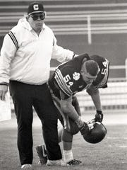 Central York football coach Brad Livingston consoles a player after the Panthers fell to Manheim Township, 24-23, in the 1990 District 3 Class AAA championship game at Hersheypark Stadium.