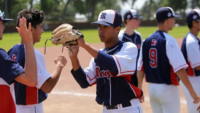 Jordan Sprinkle, center, of the Southern California Renegades celebrates Saturday's 8-3 CMWS pool play victory over Lamorinda at Worley Field. The Renegades scored 24 total runs during pool play.