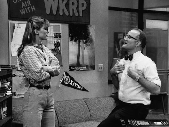 """617 Vine St., Downtown: Every """"WKRP in Cincinnati"""" episode opened with the cameras zooming in on the old Enquirer building, 617 Vine St., Downtown, the fictional home for the station where newsman Les Nessman (Richard Sanders, right, with Jan Smithers) walked out on a ledge after being banned from a stadium locker room."""