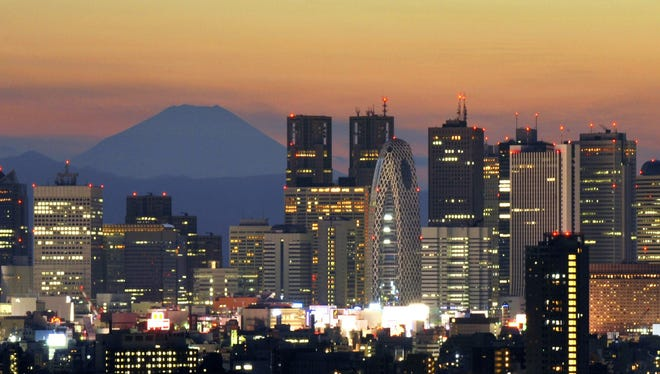 Mount Fuji looms behind Tokyo's skyline as the sun sets in 2010. Tokyo is the world's most vulnerable city when it comes to natural disasters.