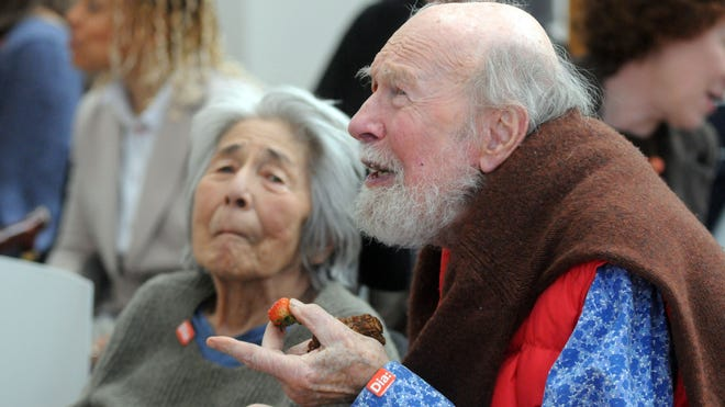 Pete Seeger speaks with attendees as an event is held at Dia:Beacon to celebrate Pete Seeger's release of a new audio book April 11, 2013, in Beacon. In the background is Seeger's wife, Toshi Seeger.