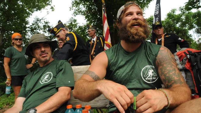 """Thomas Gathman of State College, Pennsylvania, right, a Marine Corps lance corporal, and Robert Carmel of Olympia, Washington, a retired sergeant major, were in Pawling on the Appalachian Trail while participating in the """"Walk Off War"""" program in July of last year. 2014 marks the second year for the program."""