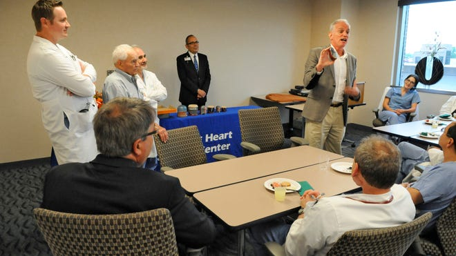 Tim Enneking presented the CentraCare Heart & Vascular Center a set of matryoshka stacking dolls depicting the doctors who performed the transcatheter aortic valve replacement procedure on his father Clarence. The matryoshka set was presented during a ceremony at the hospital July 24.