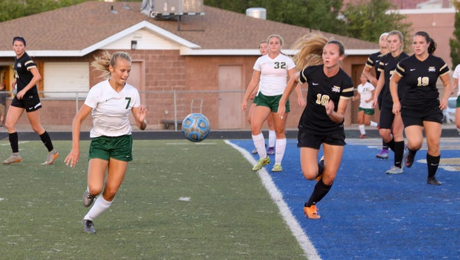 Snow Canyon's Heid Smith (No. 7) scored twice as the Warriors beat Desert Hills 2-1 on Thursday, September 8, 2016.
