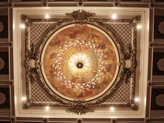 reopens cleaner rewired chandelier back in auditorium