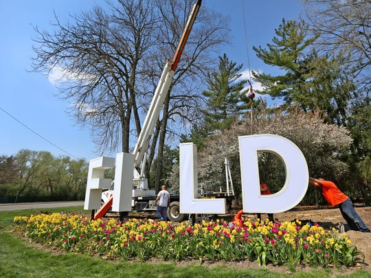 Jose Herrera, right, positions a giant D as workmen with ISF Sign Specialists install letters for Newfields, at the corner of 38th St. and Michigan, Wednesday, May 2, 2018. The capitalized letters spelling Newfields are each 10 feet tall and will be illuminated with programmable LED lights in an infinite color palette that will change with the season.  The sign concept was created by Young & Laramore and installed by ISF Sign Specialists.