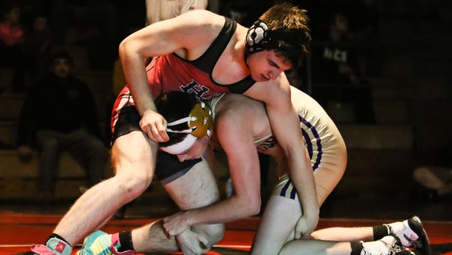 Hunterdon Central's Julian Heiligtag wrestles Monroe's Justin Hopman at 182 pounds during their Central Group IV final on Friday at Hunterdon Central.