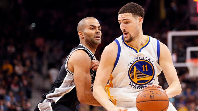 Golden State Warriors shooting guard Klay Thompson (11) dribbles around San Antonio Spurs point guard Tony Parker (9, left). The Warriors and Spurs are leading the way in the USA TODAY power rankings.