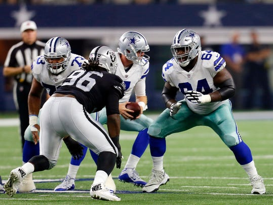 FILE - In this Aug. 26, 2017, file photo, Oakland Raiders' Denico Autry (96) and Dallas Cowboys' Jonathan Cooper (64) face off at the line of scrimmage during a preseason NFL football game in Arlington, Texas. Cooper joined the Cowboys as an afterthought in January when they were preparing for the playoffs. Now the former top 10 pick by Arizona is a starter on a Pro Bowl-laden offensive line that is starting to find last season's form.(AP Photo/Roger Steinman, File)