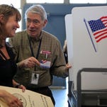 Poll worker George Jacobson shares a laugh with Andrea Smith of New City after helping her vote at Street Community Center in New City on primary day, April 19, 2016.