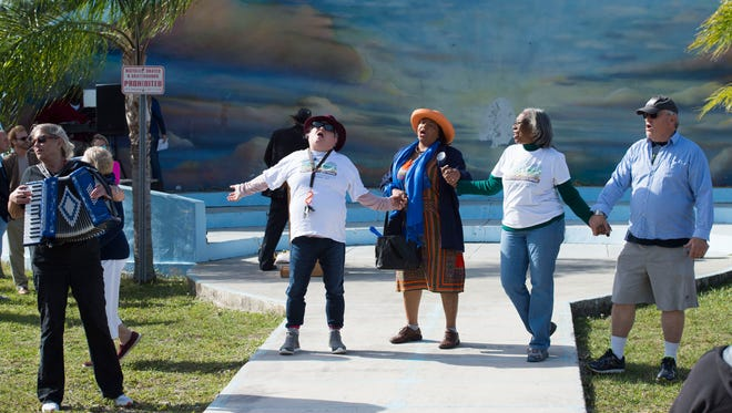 "Led by the Treasure Coast Unitarian Universalist Congregation music director Jackie May (from left); Carolyn Haykin, of Jensen Beach; Stuart commissioner Eula Clarke; Barney Miller Moore, of Port St. Lucie; and Fred Fiske, seasonal resident of Stuart, join hands and sing ""We Shall Overcome"" on Monday, Jan. 15, 2018, at East Stuart Partnership's Martin Luther King Jr. celebration at Memorial Park in Stuart. Out of Florida's 67 counties, Martin ranked as the third healthiest in the state, inching up two spots from 2017. Indian River and St. Lucie counties ranked 21 and 22, respectively, with St. Lucie jumping eight spots and Indian River dropping just slightly. Some of the areas graded were healthy behaviors, clinical care and quality of life."