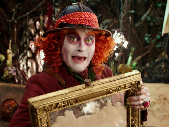A lethargic Mad Hatter (Johnny Depp) tries to rescue