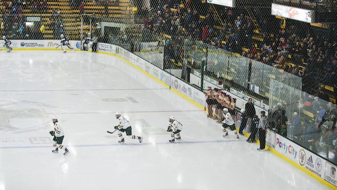 Vermont takes the ice during the men's hockey game between the New Hampshire Wildcats and the Vermont Catamounts at Gutterson Fieldhouse on Friday night February 10, 2017 in Burlington.