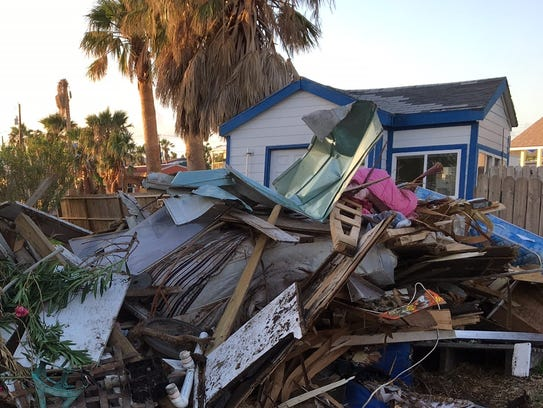 A pile of debris sits near the Freeman's property in
