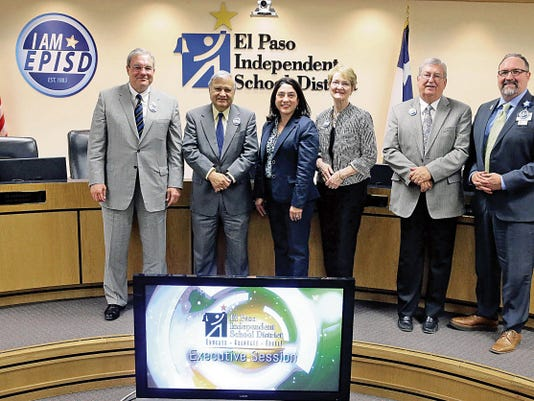 Members of the El Paso Independent School District's Board of Managers stand together for probably the last time moments before going into executive session Thursday. From left, board President Dee Margo and Managers Ed Archuleta, Carmen Arrieta-Candelaria, Judy Castleberry and Bob Geske are joined by district Superintendent Juan Cabrera. Geske won election as a trustee.
