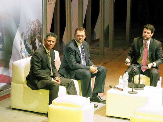 The undersecretary of electricity of the Mexican Secretariat of Energy, César Emiliano Hernández Ochoa, from left, El Paso businessman Paul L. Foster and Christopher Wilson, deputy director of the Mexico Institute at the Wilson Center, take part in a panel on Mexican energy reforms Friday at the Centro Cultural Paso Del Norte in Juárez.