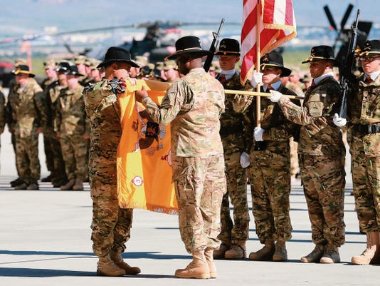 Lt. Col. R.J. Garcia, left, and Command Sgt. Major Terri Clavon case the colors of the 3rd Squadron, 6th Cavalry Regiment, Combat Aviation Brigade of the 1st Armored Division during a ceremony Tuesday at Biggs Army Airfield. The unit is deploying to Kuwait and Iraq.