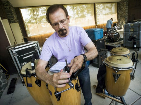 Jim Colestock prepares his percussion instruments for performance Friday night with the band Pentagon at the Codorus State Park bandshell for Codorus Blast. The event continues today and Sunday.