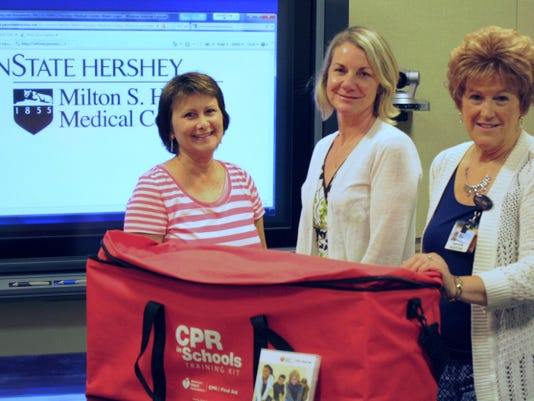 Northern York County School District nurses Brenda Baker, left, and Kathy Bagian with Tammi Bortner, program manager for the Resuscitation Sciences Training Center at Penn State Hershey Medical Center, are pictured with the new CPR in Schools Kits.