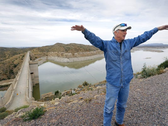 Brent Tanzy, of the Elephant Butte Division of the U.S. Bureau of Reclamation, talks about the reservoir and its importance to the region. Climate change could lead to the reservoir seeing further drops in its water level, experts warn. See more photos on PAGE A8.