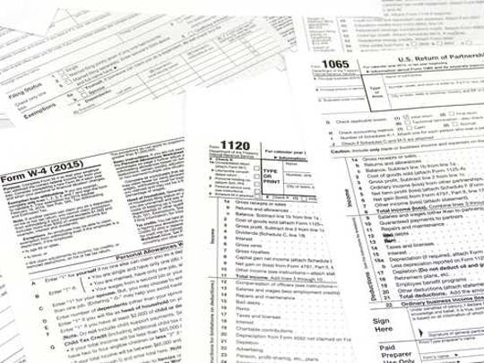 a pile of scattered tax forms.