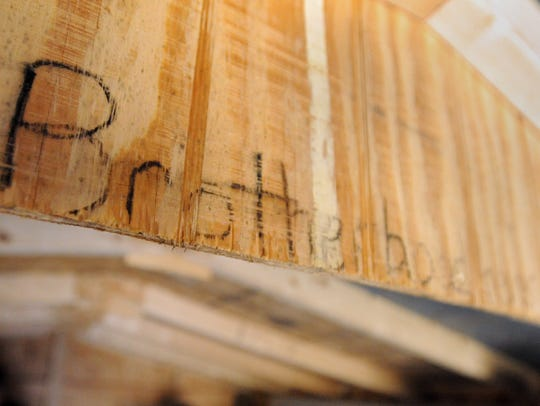 Brotherhood is written on a piece of the ceiling of